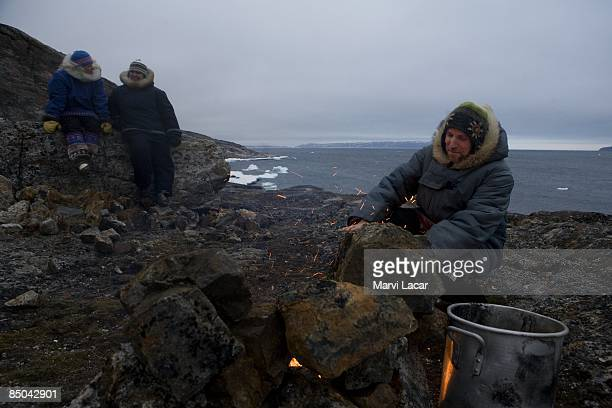 Laurent Bisbrouck makes a bonfire with friends outside the village of Ivujivik on May 31 2008 in Canada He tries to take a trip outside the village...