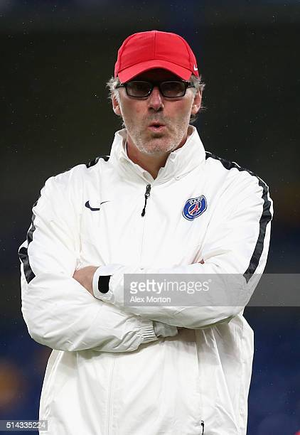 Laurent Blanc coach of Paris SaintGermain looks on during a Paris SaintGermain training session ahead of their UEFA Champions League round of 16...