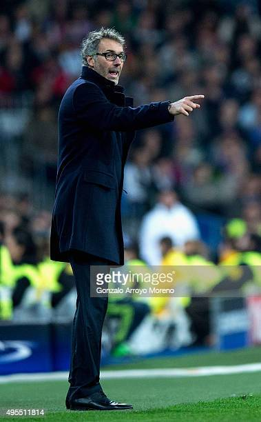 Laurent Blanc head coach of PSG gives instructions during the UEFA Champions League Group A match between Real Madrid CF and Paris SaintGermain at...