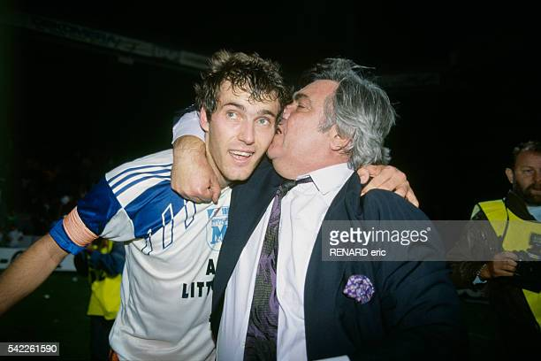 Laurent Blanc is congratulated by the President of Montpellier Herault Louis Nicollin at the end of a victorious match of the UEFA Cup Winners Cup...