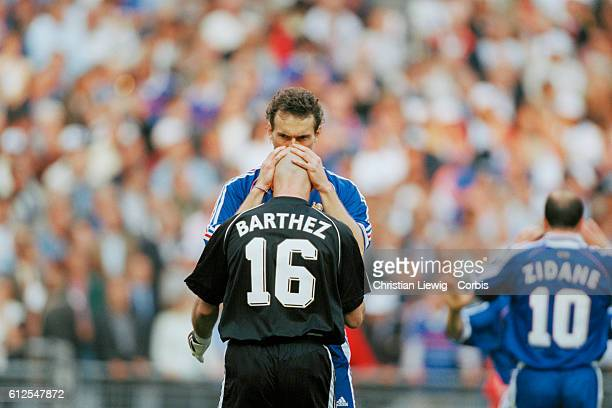 Laurent Blanc kisses French goalkeeper Fabien Barthez on the head after France's victory over Croatia in the 1998 soccer World Cup semifinal |...