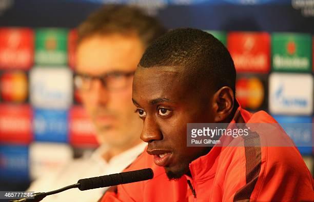 Laurent Blanc manager of Paris SaintGermain looks on as midfielder Blaise Matuidi speaks during a Paris SaintGermain press conference ahead of the...