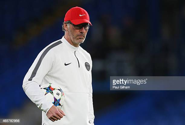 Laurent Blanc manager of Paris SaintGermain looks on during a Paris SaintGermain training session ahead of the UEFA Champions League Round of 16...