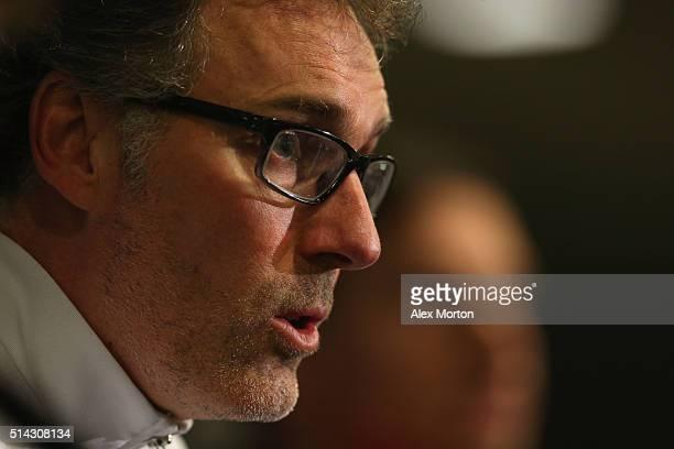 Laurent Blanc manager of Paris SaintGermain talks during a Paris SaintGermain training session ahead of their UEFA Champions League round of 16...