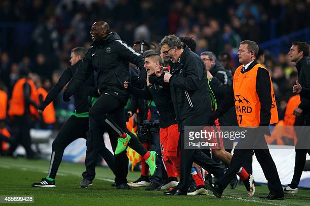 Laurent Blanc the head coach of PSG and his players celebrate following their team's victory in extra time during the UEFA Champions League Round of...