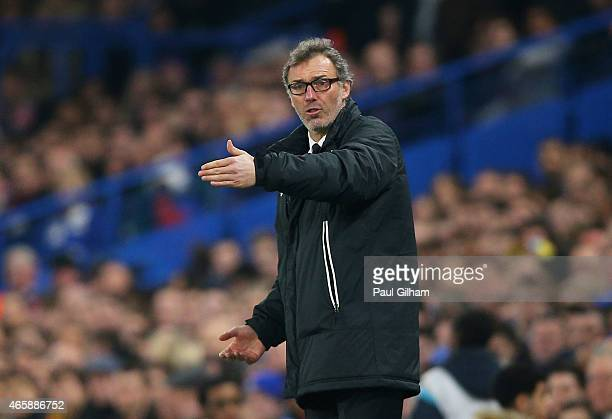 Laurent Blanc the head coach of PSG directs his players during the UEFA Champions League Round of 16 second leg match between Chelsea and Paris...