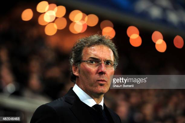 Laurent Blanc the PSG manager looks on during the UEFA Champions League quarter final first leg match between Paris Saint Germain and Chelsea at Parc...