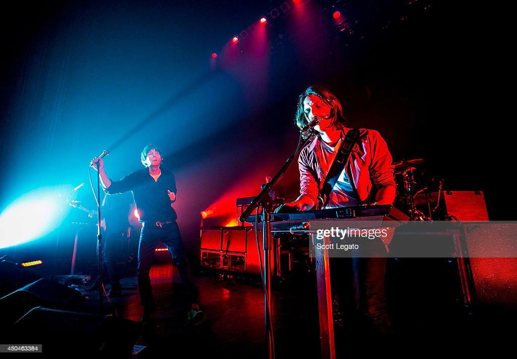 Laurent Brancowitz, Thomas Mars and Deck D'Arcy of Phoenix performs at The Fillmore on June 11, 2014 in Detroit, Michigan.