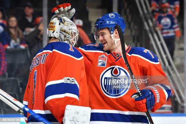 Laurent Brossoit and Oscar Klefbom of the Edmonton Oilers celebrate after winning the game against the Colorado Avalanche on March 25 2017 at Rogers...