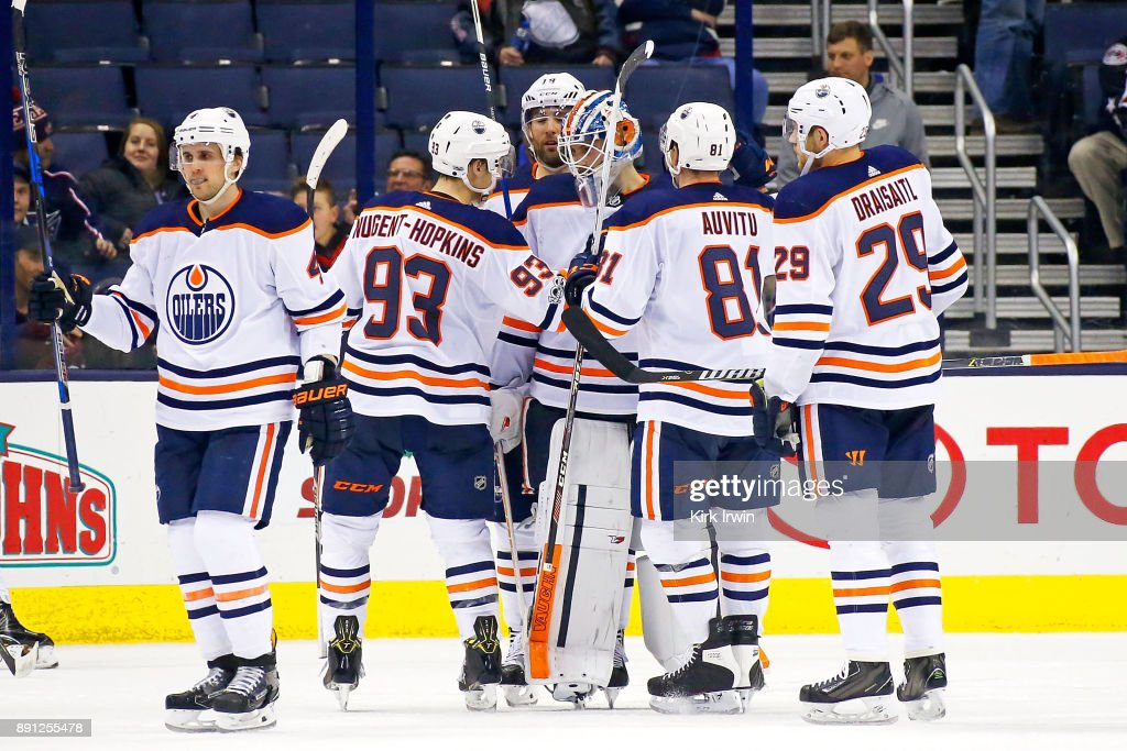 Laurent Brossoit #1 of the Edmonton Oilers is congratulated by his teammates after defeating the Columbus Blue Jackets 7-2 on December 12, 2017 at Nationwide Arena in Columbus, Ohio.