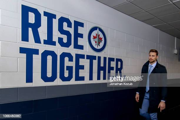 Laurent Brossoit of the Winnipeg Jets arrives at the arena prior to NHL action against the Chicago Blackhawks on Hockey Fights Cancer Night at the...