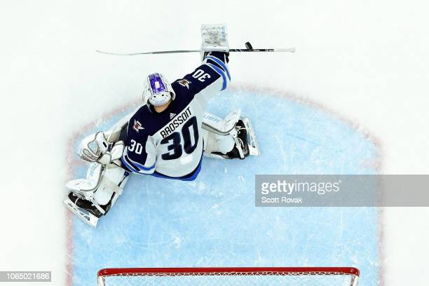 Laurent Brossoit of the Winnipeg Jets blocks a shot against the St Louis Blues at Enterprise Center on November 24 2018 in St Louis Missouri