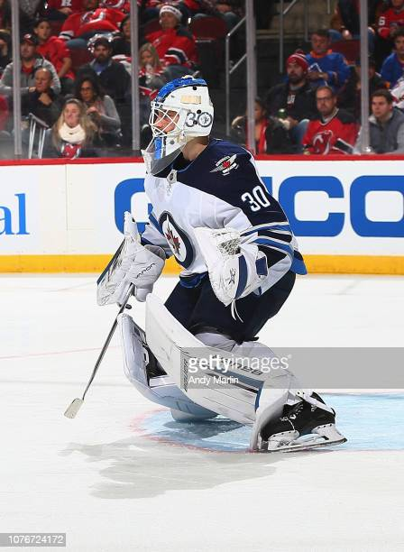 Laurent Brossoit of the Winnipeg Jets defends his net against the New Jersey Devils during the game at Prudential Center on December 1 2018 in Newark...