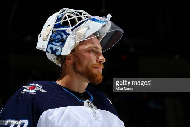 Laurent Brossoit of the Winnipeg Jets in action against the New York Islanders at Barclays Center on October 06 2019 in New York City New York...
