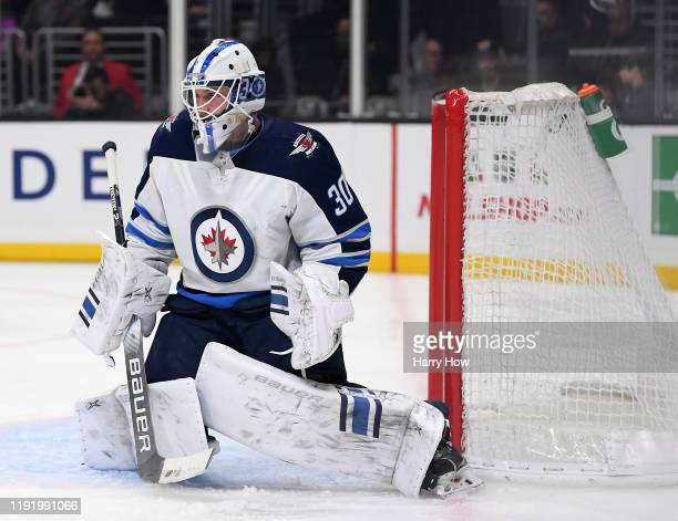 Laurent Brossoit of the Winnipeg Jets in goal during a 21 loss to the Los Angeles Kings at Staples Center on November 30 2019 in Los Angeles...