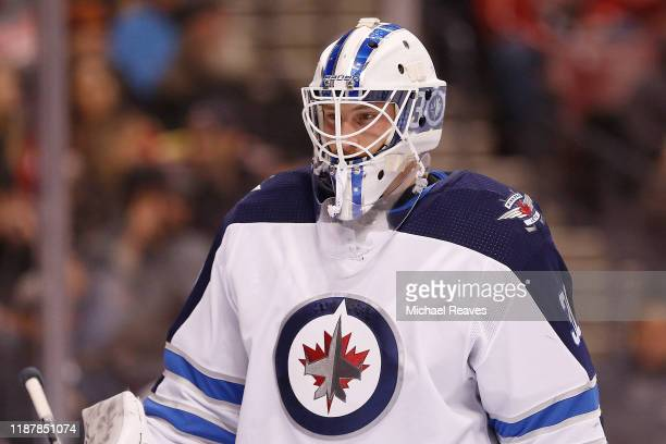 Laurent Brossoit of the Winnipeg Jets looks on against the Florida Panthers during the first period at BBT Center on November 14 2019 in Sunrise...