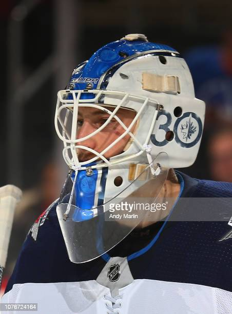 Laurent Brossoit of the Winnipeg Jets looks on against the New Jersey Devils during the game at Prudential Center on December 1 2018 in Newark New...