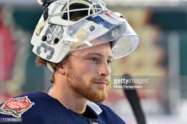 Laurent Brossoit of the Winnipeg Jets looks on during practice in advance of the 2019 Tim Hortons NHL Heritage Classic to be played against the...
