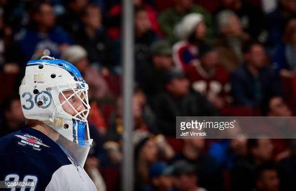 Laurent Brossoit of the Winnipeg Jets looks on from his crease during their NHL game against the Vancouver Canucks at Rogers Arena December 22 2018...