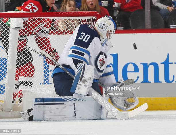 Laurent Brossoit of the Winnipeg Jets makes a save against the New Jersey Devils during the game at Prudential Center on December 1 2018 in Newark...