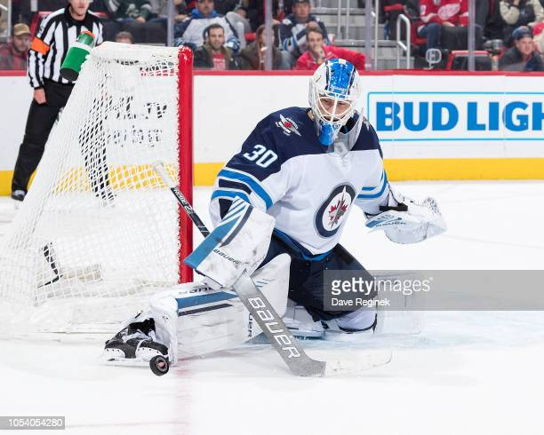 Laurent Brossoit of the Winnipeg Jets makes a skate save during an NHL game against the Detroit Red Wings at Little Caesars Arena on October 26 2018...