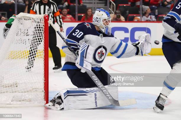Laurent Brossoit of the Winnipeg Jets plays against the Detroit Red Wings at Little Caesars Arena on October 26 2018 in Detroit Michigan
