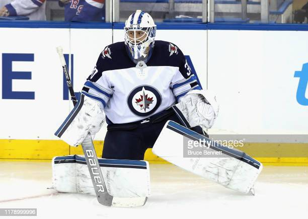 Laurent Brossoit of the Winnipeg Jets skates in warmups prior to the game against the New York Rangers at Madison Square Garden on October 03 2019 in...