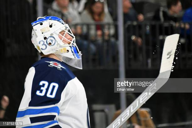 Laurent Brossoit of the Winnipeg Jets takes a break during a stop in play in the second period of a game against the Vegas Golden Knights at TMobile...