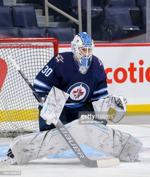 Laurent Brossoit of the Winnipeg Jets takes part in the pregame warm up prior to NHL action against the Los Angeles Kings at the Bell MTS Place on...