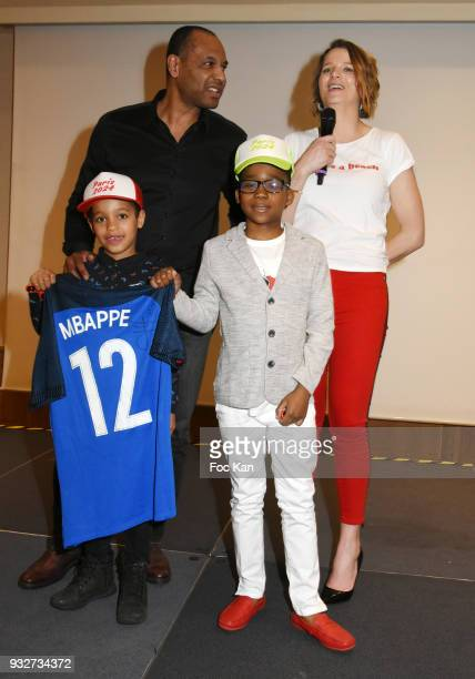 Laurent Chambertin France Pierron from Equipe TV and kids attend 'Un Maillot Pour La vie' Children Care Association Auction Gala Dinner at Hotel...