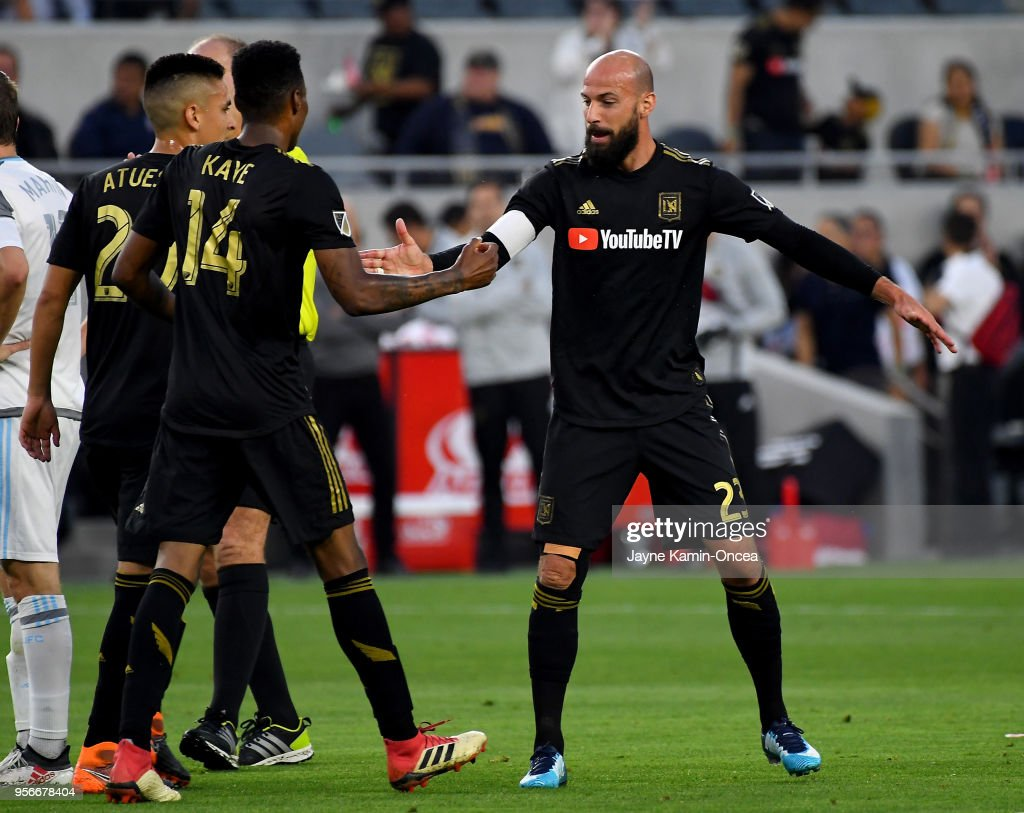 Laurent Ciman #23 and Carlos Vela #10 celebrate after a goal by Mark-Anthony Kay #14 of the Los Angeles FC in the first half of the game against the Minnesota United at Banc of California Stadium on May 9, 2018 in Los Angeles, California.