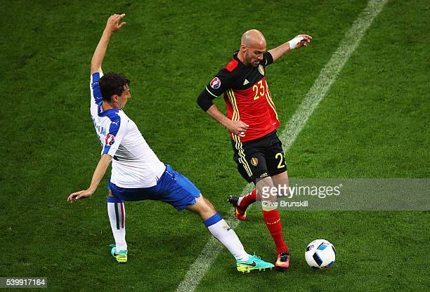Laurent Ciman of Belgium and Matteo Darmian of Italy compete for the ball during the UEFA EURO 2016 Group E match between Belgium and Italy at Stade...