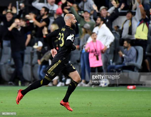 Laurent Ciman of Los Angeles FC celebrates his goal to take a 10 lead over the Seattle Sounders in extra time during the inaugural home game at Banc...