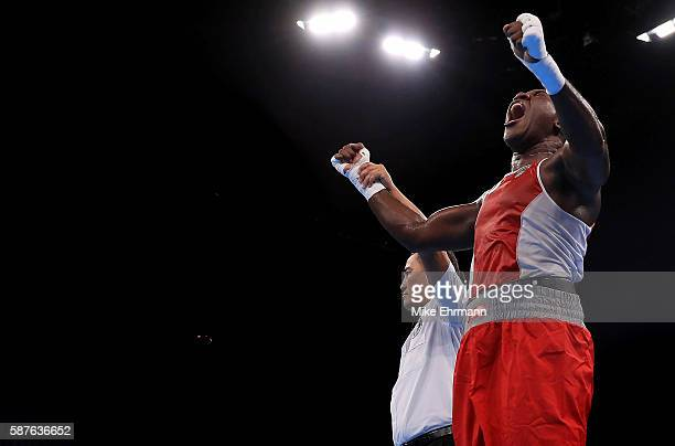 Laurent Clayton Jr of the US Virgin Islands celebrates winning his fight against Erik Pfeifer Of Germany in their Mens Super Heavyweight 91kg bout on...