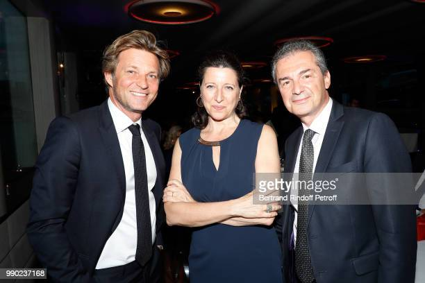 Laurent Delahousse Agnes Buzyn and Yves Levy attend Line Renaud's 90th Anniversary on July 2 2018 in Paris France