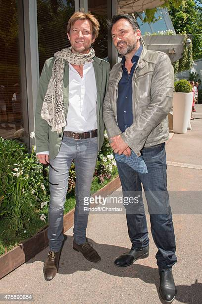 Laurent Delahousse and Frederic Lopez attend the French Open at Roland Garros on June 4 2015 in Paris France