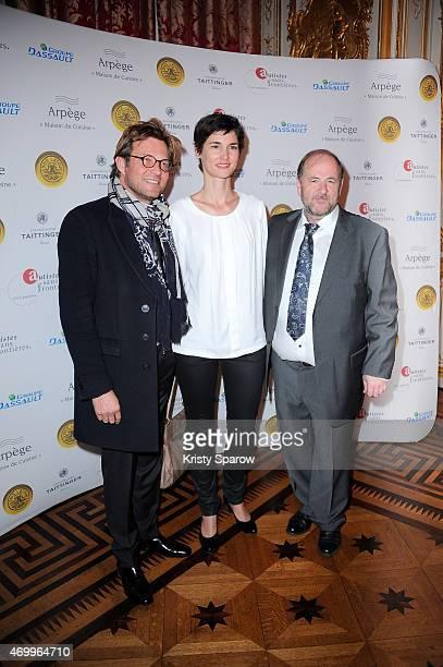Laurent Delahousse Eglantine Emeye and a guest attend the 'Autistes Sans Frontiere' Charity Gala at Artcurial Dassault on April 16 2015 in Paris...