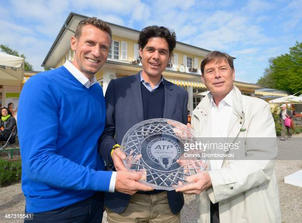 Laurent Delanney ATP CEO Europe presents Tournament Director Patrik Kuhnen and Fabian Tross Managing Director Iphitos Club with an award for being a...