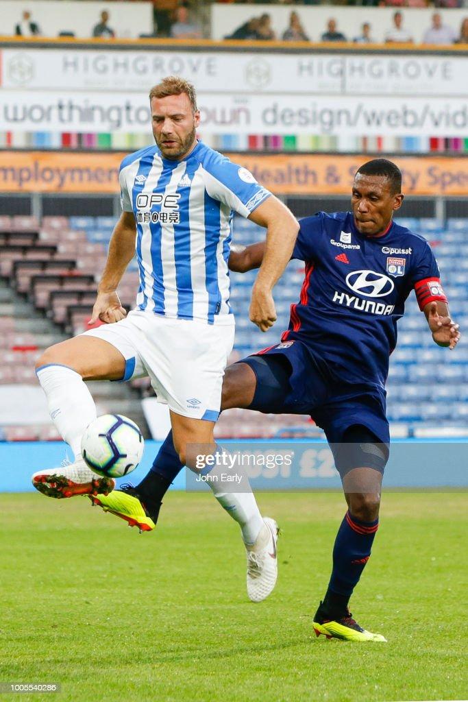 Laurent Depoitre battles with Marcelo of Olympic Lyonnais during the Huddersfield Town v Olympique Lyonnais - Pre-Season Friendly at John Smith's Stadium on July 25, 2018 in Huddersfield, England.