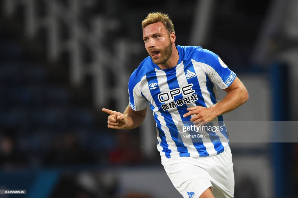 Laurent Depoitre of Huddersfield celebrates after scoring during a pre-season friendly match between Huddersfield Town and Olympique Lyonnais at John Smith's Stadium on July 25, 2018 in Huddersfield, England.