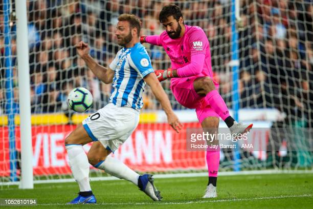 Laurent Depoitre of Huddersfield Town and Alisson Becker of Liverpool during the Premier League match between Huddersfield Town and Liverpool FC at...
