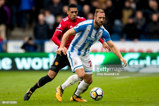 Laurent Depoitre of Huddersfield Town and Chris Smalling of Manchester United in action during the Premier League match between Huddersfield Town and...