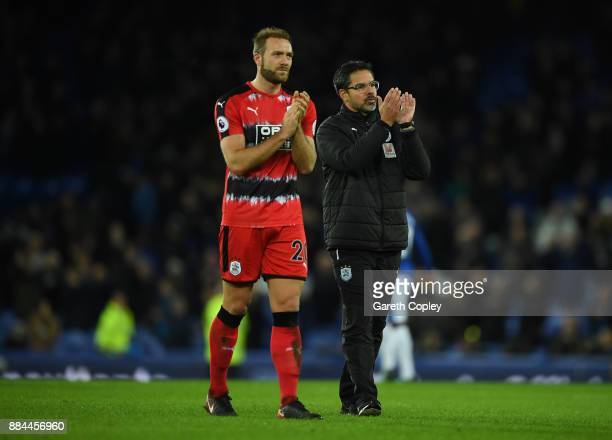 Laurent Depoitre of Huddersfield Town and David Wagner Manager of Huddersfield Town show appreciation to the fans after the Premier League match...