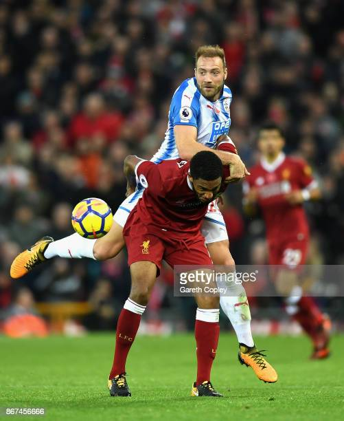 Laurent Depoitre of Huddersfield Town and Joe Gomez of Liverpool battle for possession during the Premier League match between Liverpool and...