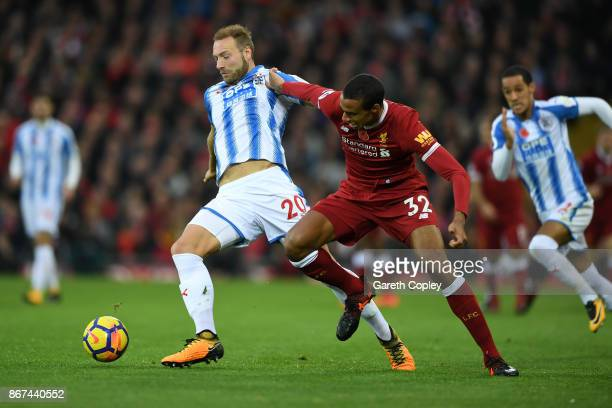 Laurent Depoitre of Huddersfield Town and Joel Matip of Liverpool battle for possession during the Premier League match between Liverpool and...
