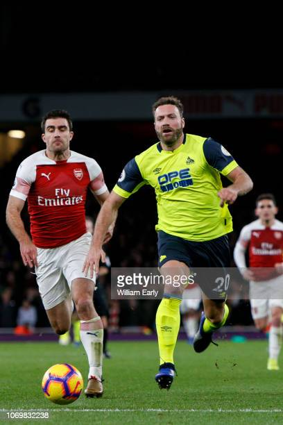 36675e4168b Laurent Depoitre of Huddersfield Town and Sokratis Papastathopoulos of  Arsenal during the Premier League match between
