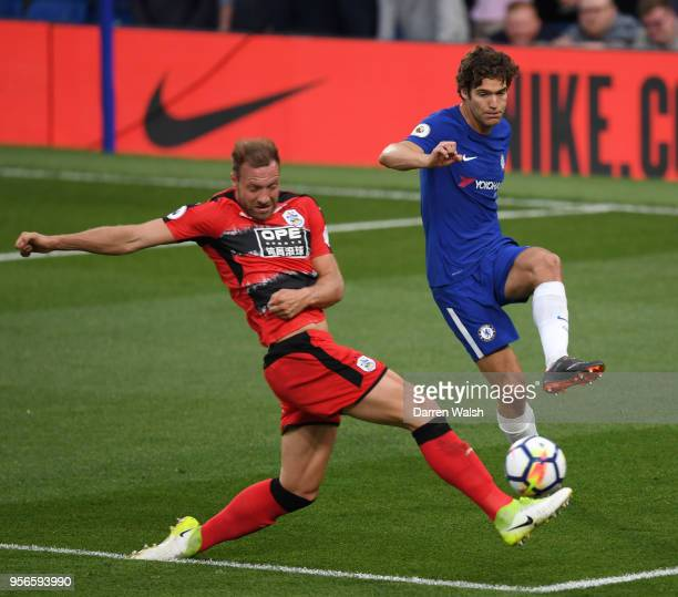 Laurent Depoitre of Huddersfield Town battles for possession with Marcos Alonso of Chelsea during the Premier League match between Chelsea and...