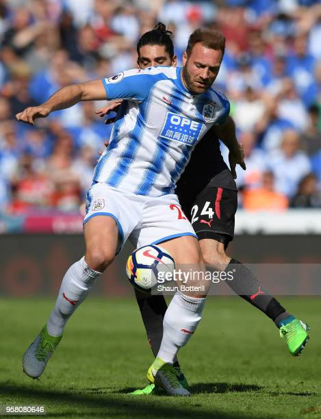 Laurent Depoitre of Huddersfield Town battles for possession with Hector Bellerin of Arsenal during the Premier League match between Huddersfield...