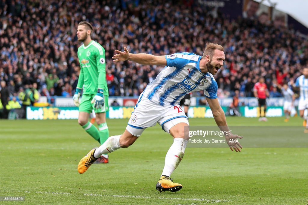 Laurent Depoitre of Huddersfield Town celebrates after scoring a goal to make it 2-0 during the Premier League match between Huddersfield Town and Manchester United at John Smith's Stadium on October 21, 2017 in Huddersfield, England.