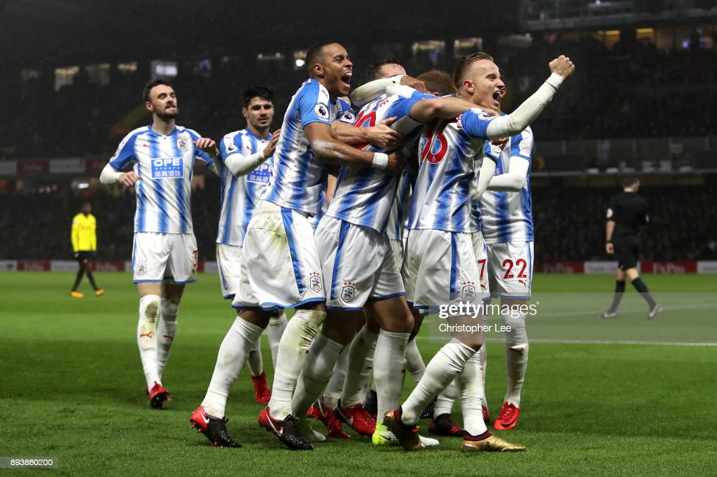 Laurent Depoitre of Huddersfield Town celebrates after scoring his sides third goal with his Huddersfield Town team mates during the Premier League match between Watford and Huddersfield Town at Vicarage Road on December 16, 2017 in Watford, England.